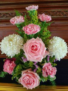 Flower arrangement roses, carnation, lavendar, daisy and foliage