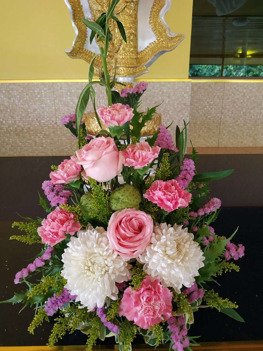 Flower arrangement roses, carnation, lavendar, daisy and foliage